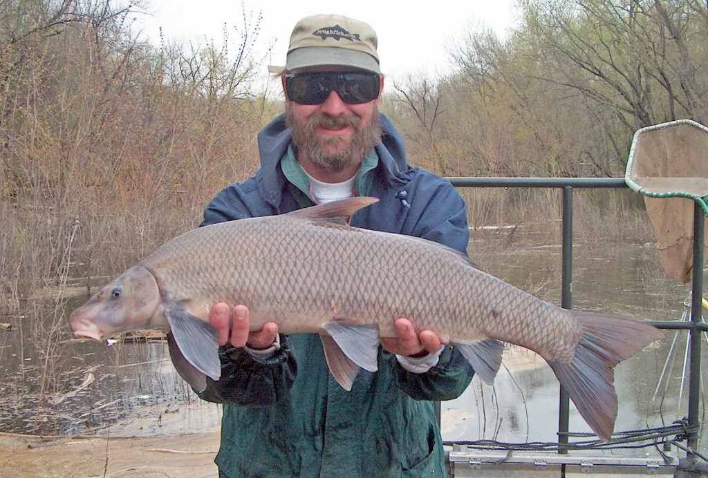 Corey Geving holding a Blue Sucker.